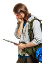 Backpacker man using pc tablet browsing internet. Royalty Free Stock Photo