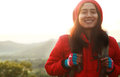Backpacker portrait asian young woman hiking smiling look on you camera Royalty Free Stock Photo