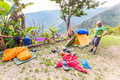 Backpacker standing tent morning mess gear disorder, camping mountains Bolivia. Royalty Free Stock Photo