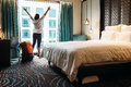 Backpacker traveller happy to stay hotel Royalty Free Stock Photo