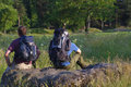 Backpackers in sunny field Stock Photography