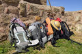 Backpacking of pilgrims backpacks way saint james rest beside a ruin Stock Image