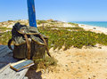 Backpacking traveller in a beach rest tavira island algarve portugal backpack and book on the porch of wooden hut next to the Stock Photography