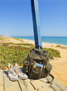Backpacking traveller in a beach rest tavira island algarve portugal backpack and shoes on the porch of wooden hut next to the Royalty Free Stock Images