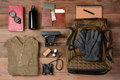 Backpacking trip overhead view of gear laid out for a on a rustic wood floor items include backpack gloves sweater camera film Stock Photography