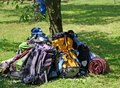 Backpacks of boy scouts around the tree during an excursion in nature park Stock Images