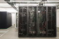 Backside of arranged black server racks Royalty Free Stock Photo