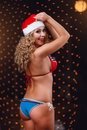 Backside of a curly-headed girl in a bikini and red hat Royalty Free Stock Photo