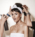 Backstage photo bridal rituals before wedding beautiful brunette woman with retro hairdo and makeup luxury vogue style model Stock Photo