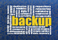 Backup and data recovery word cloud with a binary background Royalty Free Stock Image