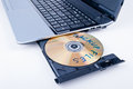 Backup files the cd or dvd with on laptop cd or dvd tray Royalty Free Stock Photography