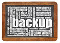 Backup word cloud on an isolated vintage blackboard Royalty Free Stock Photos