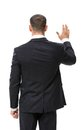 Backview of businessman waving hand isolated on white Stock Photo