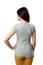 Backview portrait of a young woman standing isolated on white background Stock Images
