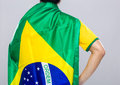 Backview of sportman wear with brazil flag gray background Stock Photography