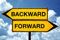 Backward or forward opposite signs two opposite signs against blue sky background Stock Image