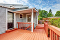 Backyard of craftsman home with red deck Royalty Free Stock Photo