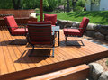 Backyard deck with chairs and table Royalty Free Stock Images