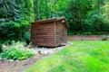 Backyard garden with wooden shed beautiful green Stock Photos