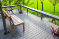 Backyard porch relax corner beside rice field with sunlight Royalty Free Stock Image