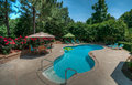 Backyard swimming pool on a sunny day nice inviting at the house Stock Images