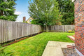 Backyard with wooden fence and walkway Royalty Free Stock Photo