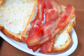 Bacon on buttered bread Royalty Free Stock Photo