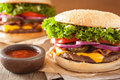 Bacon cheese burger with pickles tomato onion Royalty Free Stock Photo