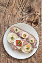 Bacon Cheese Egg Ham and Tomato Sandwich on Wooden Background Royalty Free Stock Photo