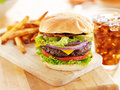 Bacon cheeseburger with french fries and soft drink Stock Photo