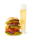 Bacon double cheeseburger with tall beer a very hamburger stacked two beef patties crisp cheddar cheese blue cheese grilled onions Royalty Free Stock Photo