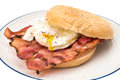 Bacon and egg bagel breakfast fried white background Royalty Free Stock Photos