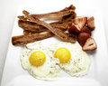 Bacon and eggs breakfast of with strawberries Stock Image