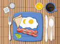 Bacon and eggs illustration of meal on a bamboo mat Royalty Free Stock Photography