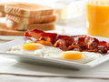 Bacon, eggs and toast breakfast Royalty Free Stock Photography