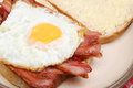 Bacon fried egg sandwich and Royalty Free Stock Images