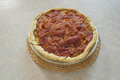 Bacon lattice top pie home made mashed potato sitting on table on a wicker hot pad Royalty Free Stock Photography