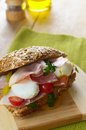 Bacon and poached eggs sandwich on the cut board Royalty Free Stock Photography