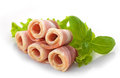 Bacon rolls and basil on white background Stock Photos