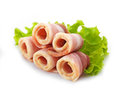 Bacon rolls and lettuce on white background Stock Image