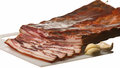 Bacon sliced with garlic on white background greasy Stock Photos