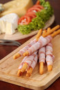 Bacon wrapped grissini and cheese Stock Photo