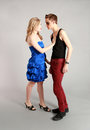 Bad boy good girl opposites attract couple teens in studio Royalty Free Stock Images