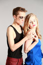 Bad boy good girl opposites attract teen couple in love Royalty Free Stock Images
