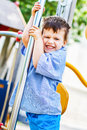 Bad boy slip down on pole at playground childhood Royalty Free Stock Photo