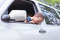 Bad feeling baby out of window Royalty Free Stock Photo