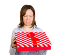 Bad gift idea closeup portrait of woman holding red box looking inside very displeased with what she received isolated on white Royalty Free Stock Photo