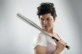 Bad girl with baseball bat portrait of a tough a resting on her shoulder Stock Photo