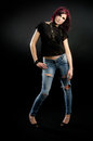 Bad girl with torn jeans Stock Photos