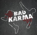 Bad karma chalk outline dead body violent reaction poor treatmen words on a of a or murdered to illustrate someone who has wronged Stock Photography